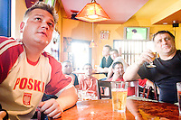 Fans of Poland watch their team play Ecuador on June 9, 2006 at a bar in a Polish neighborhood of Brooklyn, Greenpoint. <br /> <br /> The World Cup, held every four years in different locales, is the world's pre-eminent sports tournament in the world's most popular sport, soccer (or football, as most of the world calls it).  Qualification for the World Cup is open to any country with a national team accredited by FIFA, world soccer's governing body. The first World Cup, organized by FIFA in response to the popularity of the first Olympic Games' soccer tournaments, was held in 1930 in Uruguay and was participated in by 13 nations.    <br /> <br /> As of 2010 there are 208 such teams.  The final field of the World Cup is narrowed down to 32 national teams in the three years preceding the tournament, with each region of the world allotted a specific number of spots.  <br /> <br /> The World Cup is the most widely regularly watched event in the world, with soccer teams being a source of national pride.  In most nations, the whole country is at a standstill when their team is playing in the tournament, everyone's eyes glued to their televisions or their ears to the radio, to see if their team will prevail.  While the United States in general is a conspicuous exception to the grip of World Cup fever there is one city that is a rather large exception to that rule.  In New York City, the most diverse city in a nation of immigrants, the melting pot that is America is on full display as fans of all nations gather in all possible venues to watch their teams and celebrate where they have come from.