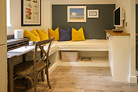 BNPS.co.uk (01202) 558833. <br /> Pic: Bidwells/BNPS<br /> <br /> Pictured: Lounge space.<br /> <br /> Better than a gravy boat...<br /> <br /> A striking country house built by a bishop as a wedding gift for his son is on the market for offers over £2m.<br /> <br /> Dunbeg House sits in an incredible position on the bank of a loch with stunning panoramic water and mountain views.<br /> <br /> The impressive property not only includes the five-bedroom main house, but also a two-bedroom cottage that has been run as a successful holiday let and over four acres of woodland garden.