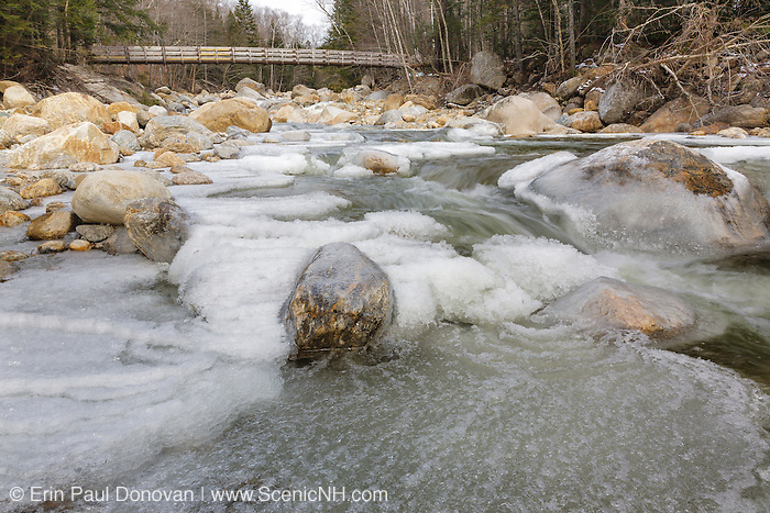 Looking upstream at the foot bridge that crosses the Dry River along the Dry River Trail in Cutt's Grant of the New Hampshire White Mountains.