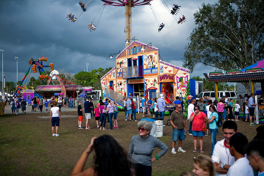 MAE GAMMINO/SPECIAL TO SCRIPPS TREASURE COAST NEWSPAPERS<br /> <br /> The fairground is busy with activity, from rides to food vendors, during the 2013 Saint Helen's Harvest Festival on Sunday at Historic Dodgertown in Vero Beach.  This marks the 49th year for the festival which is held to benefit Saint Helen's School.
