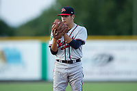 Danville Braves starting pitcher Dilmer Mejia (32) looks to his catcher for the sign against the Burlington Royals at Burlington Athletic Stadium on August 12, 2017 in Burlington, North Carolina.  The Braves defeated the Royals 5-3.  (Brian Westerholt/Four Seam Images)