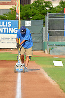 The Ogden Raptors grounds crew prepares the field prior to the game against the Idaho Falls Chukars in Pioneer League action at Lindquist Field on July 26, 2014 in Ogden, Utah.  (Stephen Smith/Four Seam Images)