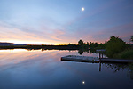 IDaho, South central, Camas County, Fairfield, A kids fishing pond in the pre-dawn light with crscent moon reflecting in the calm water.