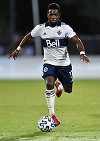 LAKE BUENA VISTA, FL - JULY 26: Cristian Dájome of Vancouver Whitecaps FC dribbles the ball during a game between Vancouver Whitecaps and Sporting Kansas City at ESPN Wide World of Sports on July 26, 2020 in Lake Buena Vista, Florida.