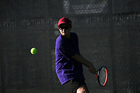 Catholic's Isaiah Bordador hits, Monday, October 11, 2021 during the 6A state girls and boys tennis tournament at Memorial Park in Bentonville. Check out nwaonline.com/211012Daily/ for today's photo gallery. <br /> (NWA Democrat-Gazette/Charlie Kaijo)