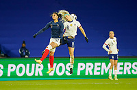 LE HAVRE, FRANCE - APRIL 13: Julie Ertz #8 of the United States leaps higher than Valérie Gauvin #13 of France during a game between France and USWNT at Stade Oceane on April 13, 2021 in Le Havre, France.