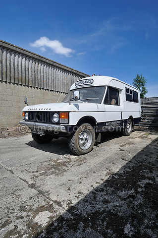 1970 Range Rover VELAR pre-production, first to be converted to an Ambulance - YVB 158H. Dunsfold Collection of Land Rovers 2011, Dunsfold, Surrey, UK. --- No releases available, but releases may not be necessary for certain uses. Automotive trademarks are the property of the trademark holder, authorization may be needed for some uses. --- Vehicle Information: Belonging to the Dunsfold Collection of Land Rovers: Chassis number 35500010A, registration number YVB 158H, engine type 3.5 L petrol, gearbox type: 4-speed manual. --- Vehicle History: Range Rover YVB 158H is one of the pre-production Velar vehicles and was the first to be stretched and converted to an ambulance. The body was built by Wadham Stringer. This is possibly the most original Velar, having never needed to be restored. It was owned and used by the British Red Cross until 1991 when it was sold to collector. In 2001 YVB 158H was purchased by Dunsfold. Many original features still exist like the smooth dash and aluminium bonnet.
