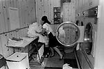 HM Prison Styal Wilmslow Cheshire UK 1980s. Womens prison,female prisoner doing her laundry 1986.