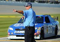 Feb 08, 2009; Daytona Beach, FL, USA; A track worker directs NASCAR Sprint Cup Series driver Terry Labonte to the garage following his run during qualifying for the Daytona 500 at Daytona International Speedway. Mandatory Credit: Mark J. Rebilas-