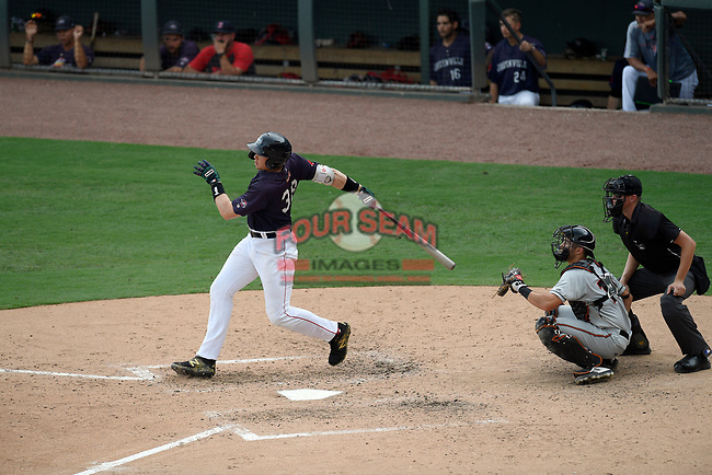 First baseman Triston Casas (38) of the Greenville Drive bats in a game against the Delmarva Shorebirds on Friday, August 2, 2019, in the continuation of rain-shortened game begun August 1, at Fluor Field at the West End in Greenville, South Carolina. The catcher is Cody Roberts and the umpire is Ben Engstrand. Delmarva won, 8-5. (Tom Priddy/Four Seam Images)