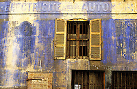 Facade of an abandoned old commercial building, Marseille, France.