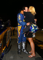 Nov 12, 2016; Pomona, CA, USA; NHRA funny car driver Ron Capps kisses wife Shelly Capps celebrates after clinching the 2016 funny car world championship during qualifying for the Auto Club Finals at Auto Club Raceway at Pomona. Mandatory Credit: Mark J. Rebilas-USA TODAY Sports