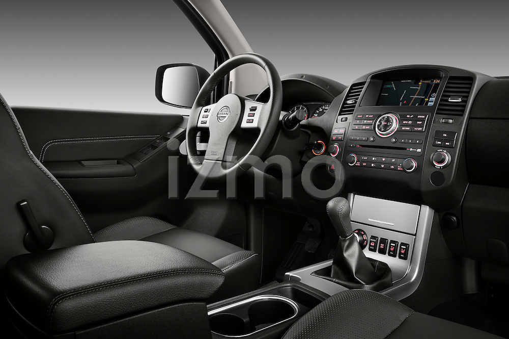 Passenger side dashboard view of a 2010 Nissan Navara LE 4 door Pick-Up Truck.