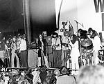 John Lennon 1969 with Jim Price, Bobby Keys, George Harrison, Eric Clapton, Delaney Bramlett, Bonnie Bramlett, Yoko Ono and John Lennon at the Lyceum, December 15th 1969 © Chris Walter.<br /> <br /> Lennon, Harrison, Clapton and Delaney Bramlett (guitars, with Clapton playing Rocky, Harrison's psychedelic Fender Stratocaster); Ono (vocals); Bonnie Bramlett (tambourine); Alan White and Jim Gordon (drums); Billy Preston (organ); Klaus Voormann (bass guitar); Bobby Keys (saxophone); Jim Price (trumpet). Lennon later referred to it as the Plastic Ono Supergroup.
