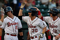 Right fielder Ryan Scott (30) of the Greenville Drive is greeted after hitting a grand slam home run in a game against the Columbia Fireflies on Wednesday, August 23, 2017, at Fluor Field at the West End in Greenville, South Carolina. Greenville won, 16-5. (Tom Priddy/Four Seam Images)
