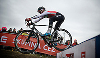 Joel Grab (SUI) bunny-hopping the barriers<br /> <br /> Men Juniors Race<br /> <br /> 2015 UCI World Championships Cyclocross <br /> Tabor, Czech Republic