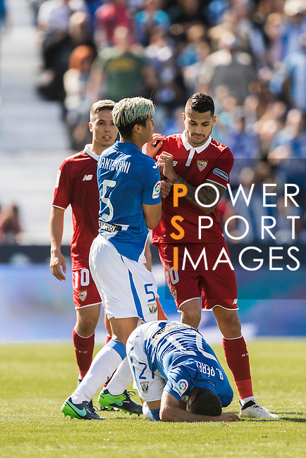 Vitolo of Sevilla FC clashes with Martin Mantovani of Deportivo Leganes as Ruben Perez of Deportivo Leganes is injured during their La Liga match between Deportivo Leganes and Sevilla FC at the Butarque Municipal Stadium on 15 October 2016 in Madrid, Spain. Photo by Diego Gonzalez Souto / Power Sport Images
