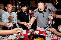 Guests at a wedding reception make toasts with Baijiu, a strong grain spirit. The wedding party is one of four being held at The West Lake Restaurant on the same night. Able to seat up to 5,000 people at one sitting, The West Lake Restaurant is the biggest Chinese restaurant in the world. Each week its diners, who staff are taught are 'the bringers of good fortune', devour 700 chickens, 200 snakes, 1,200 kgs of pork and 1,000 kgs of chillis. Its 300 chefs cook in five kitchens and its staff total more than 1,000.It is fully booked most nights.