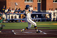 Michigan Wolverines first baseman Jake Marti (7) swings the bat in the ninth against the Michigan State Spartans on March 21, 2021 in NCAA baseball action at Ray Fisher Stadium in Ann Arbor, Michigan. Michigan scored 8 runs in the bottom of the ninth inning to defeat the Spartans 8-7. (Andrew Woolley/Four Seam Images)