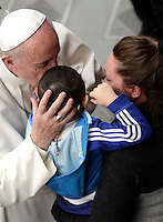 Papa Francesco bacia un bambino al termine dell'Udienza Generale del mercoledi' in aula Paolo VI, Citta' del Vaticano, 18 gennaio 2017.<br /> Pope Francis kisses a child at the end of his weekly general audience in Paul VI Hall at the Vatican, on January 18, 2017.<br /> UPDATE IMAGES PRESS/Isabella Bonotto<br /> <br /> STRICTLY ONLY FOR EDITORIAL USE