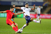 SWANSEA, WALES - NOVEMBER 12: Sebastian Lletget #17 of the United States  attempts to block a ball by Tom Lockyer #5 of Wales during a game between Wales and USMNT at Liberty Stadium on November 12, 2020 in Swansea, Wales.