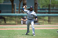 AZL Padres 2 relief pitcher Vijay Miller (38) throws to first base during an Arizona League game against the AZL Dodgers at Camelback Ranch on July 4, 2018 in Glendale, Arizona. The AZL Dodgers defeated the AZL Padres 2 9-8. (Zachary Lucy/Four Seam Images)