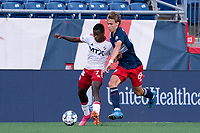 FOXBOROUGH, MA - JUNE 26: Bernard Kamungo #7 of North Texas SC prepares to pass as Noel Buck #61 of the New England Revolution pressures during a game between North Texas SC and New England Revolution II at Gillette Stadium on June 26, 2021 in Foxborough, Massachusetts.