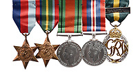 BNPS.co.uk (01202) 558833<br /> Pic: Woolley&Wallis/BNPS<br /> <br /> Donald Grist's medals are part of the sale<br /> <br /> Paintings secretly produced by a British woman inside a hellish Japanese prisoner of war camp using brushes made from human hair have come to light.<br /> <br /> Isobel Grist depicted scenes of camp life while she and her husband Donald spent three years imprisoned at the notorious Changi PoW camp in Singapore.<br /> <br /> The talented artist had grabbed her paints just as the couple were marched off to the camp following the fall of Singapore in 1942.