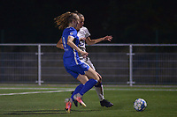 Lisa Petry (9) of KRC Genk and Marie Van Caesbroeck (15) of Anderlecht battle for the ball during a female soccer game between  Racing Genk Ladies and Royal Sporting Club Anderlecht , a delayed game from the 1st  matchday of the 2021-2022 season of the Belgian Scooore Womens Super League , tuesday 28 September 2021  in Genk , Belgium . PHOTO SPORTPIX | JILL DELSAUX
