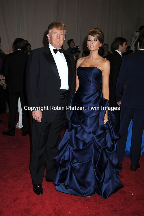 Donald Trump and Melania Trump arriving at The Costume Institute Gala Benefit celebrating American Woman: Fashioning a National Identity at The Metropolitan Museum of Art on May 3, 2010 in New York City.