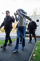 """Pictured: Mark Hayter (C) arrives at Merthyr Tydfil Crown Court, Wales, UK. Tuesday 05 November 2019<br /> Re: Blundering ram raiders who escaped with an ATM machine containing £80,000 unaware it was fitted with a secret tracking device, have been jailed for a total of twenty years by Merthyr Tydfil Crown Court.<br /> The masked gang took the cash machine to a deserted farmhouse where a security monitoring company picked up its GPS signals.<br /> The money was being """"divvied up"""" when police swooped to arrest the five gang members and seize a bin bag packed with £20 and £10 notes<br /> A jury was shown dramatic video of the gang reversing a 4X4 vehicle into a Valleys Co-op store in the early hours.<br /> Prosecutor Alex Greenwood said: """"The peace of Treharris village was interrupted by an audacious criminal enterprise.<br /> """"It was a highly-organised burglary to remove the ATM from the Co-op store.<br /> """"A masked criminal gang reversed a Mitsubishi pick-up into the front of the shop. <br /> """"Straps were attached to the machine and the pick-up drove off dragging it down the street with sparks flying off it."""