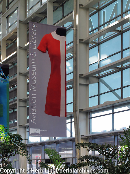 """Banner announcing the """"Fashion in Flight: Airline Uniform Design"""" exhibition of SFO Museums at the San Francisco Airport Commission Aviation Library and Louis A. Turpin Aviation Museum in the international terminal of San Francisco International airport (SFO), San Francisco, California"""