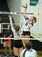 Fayetteville's Perry Flannigan (11) sends the ball over the net Tuesday, Sept. 15, 2020, as Bentonville's Maddy Hughes (4) defends during play in Tiger Arena in Bentonville. Visit nwaonline.com/200916Daily/ for today's photo gallery. <br /> (NWA Democrat-Gazette/Andy Shupe)
