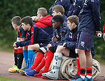 Youth players watching training