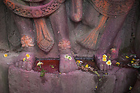 Hindu devotees put flower on a statue as they take part in a prayer at Bhaktapur, near Kathmandu, Nepal.  May 03, 2015
