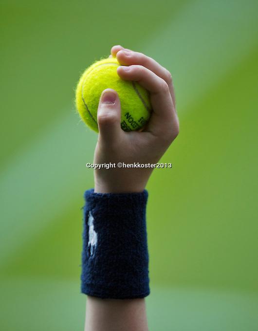 26-06-13, England, London,  AELTC, Wimbledon, Tennis, Wimbledon 2013, Day three, Ballkid holding ball<br /> <br /> <br /> <br /> Photo: Henk Koster