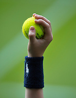 26-06-13, England, London,  AELTC, Wimbledon, Tennis, Wimbledon 2013, Day three, Ballkid holding ball<br /> <br /> <br /> <br /> Photo: Henk Koster