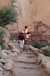 Asian parents with children hiking up the Bright Angel Trail to the South Rim of the Grand Canyon, Arizona. . John offers private photo tours in Grand Canyon National Park and throughout Arizona, Utah and Colorado. Year-round.