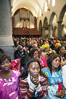 Switzerland. Canton Valais. St-Maurice. Africa Saints Pilgrimage (Pèlerinage aux Saints d'Afrique). Religious <br /> ceremony in St-Maurice's abbey. African women and men gather for a catholic mass. 2.06.13 © 2013 Didier Ruef