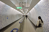A pedestrian walkway in Green Park underground station, London.