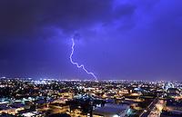 Aug. 21, 2012; Phoenix, AZ, USA: lightning bolt storm monsoon rain city Phoenix strike thunderstorm lights Mandatory Credit: Mark J. Rebilas