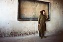 Iran 1982.In a school near Oushnavie, a schoolboy in the classroom