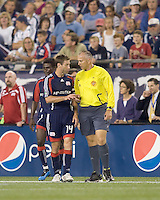 New England Revolution midfielder Steve Ralston (14) discusses red card ejection of teammate with Jasen Anno. The Kansas City Wizards  defeated New England Revolution, 4-2, at Gillette Stadium on September 5, 2009.