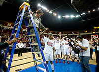 FRESNO, CA--Tara VanDerveer is helped down the ladder after giving senior Nneka Ogwumike the net after a 81-69 win over Duke at the Save Mart Center for the West Regionals Championship of the 2012 NCAA Championships. The Cardinal advances to the Final Four in Denver, facing Baylor in the semifinals.