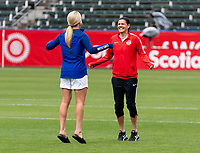 CARSON, CA - FEBRUARY 9: Lindsey Horan #9 of the United States talks with Christine Sinclair #12 of Canada during a game between Canada and USWNT at Dignity Health Sports Park on February 9, 2020 in Carson, California.