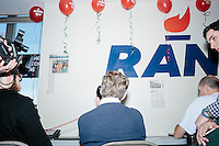Kentucky senator and Republican presidential candidate Rand Paul calls potential voters at the phone bank at his campaign headquarters in Manchester, New Hampshire.