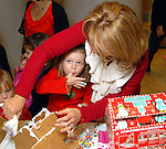 Audry Garner samples the frosting while her mother Holly helps her build a gingerbread house at the fourth annual Home Sweet Home Gingerbread Bash presented by BBVA Compass benefitting the Children's Museum  Saturday Dec. 05,2009. (Dave Rossman/For the Chronicle)