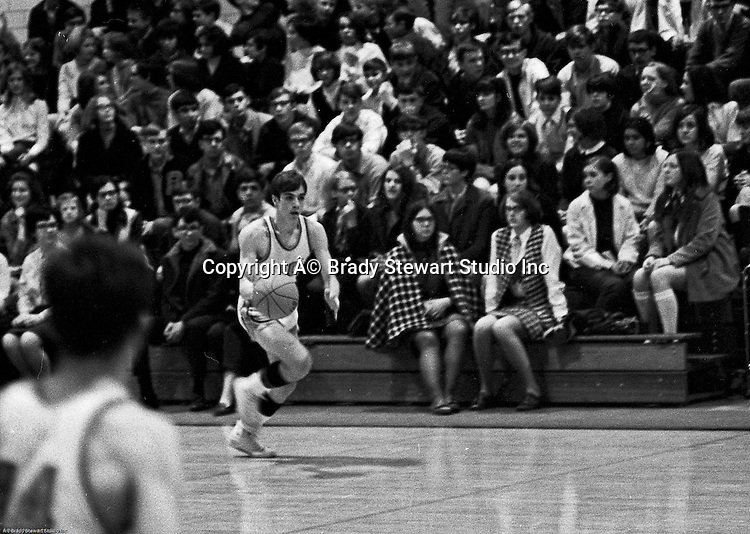 Bethel Park PA:  Mike Stewart 10 dribbling up the court during a basketball game against the Mt Lebanon Blue Devils at Bethel Park Gymnasium. Bruce Evanovich is in the foreground. The JV Team was coached by Mr. Reno and the Bethel Park JVs won the Section Championship.  The team included; Scott Streiner, Steve Zemba, John Klein, Mike Stewart, Bruce Evanovich, Jeff Blosel, and Tim Sullivan.