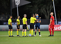 LAKE BUENA VISTA, FL - JULY 26: Referee Alex Chillowicz flips the coin as Alexander Ring of New York City FC and Michael Bradley of Toronto FC look on during a game between New York City FC and Toronto FC at ESPN Wide World of Sports on July 26, 2020 in Lake Buena Vista, Florida.