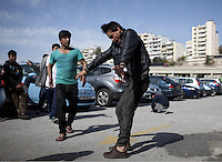 Pictured: Teenage migrants dance at the port Monday 07 March 2016<br /> Re: Migrants have been gathering at the port of Piraeus, near Athens, Greece.
